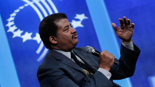 Neil deGrasse Tyson, pictured speaking at the Clinton Global Initiative's 2015 annual meeting in New York City, will appear at the Count Basie Theatre in Red Bank this May,