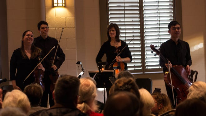 Kate Ryan, Daniel Gilbert, Beth Luscombe and Weipeng Liu rise to audience applause after playing their second piece.
