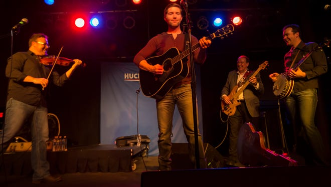 Former Governor Mike Huckabee makes a campaign stop with country musician Josh Turner at Wooly's in Des Moines, Monday, Jan. 25, 2016.