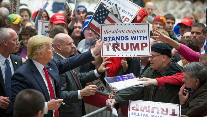 Donald Trump greets guests at a rally on Jan. 26, 2016, in Marshalltown, Iowa.