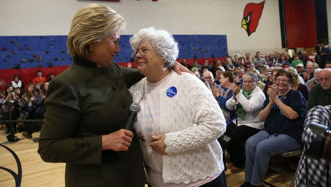 Hillary Clinton embraces 73-year-old Annette Bebout as she tells a story about losing her home during a campaign event at Berg Middle School on Jan. 28, 2016, in Newton, Iowa.