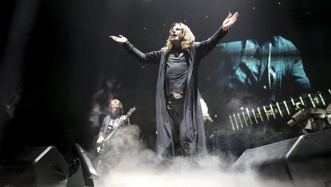 Geezer Butler (left) and Ozzy Osbourne of Black Sabbath perform at the United Center on Jan. 22 2016 in Chicago.
