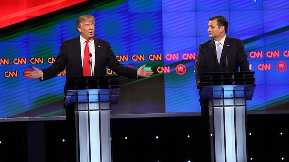 Donald Trump and Ted Cruz take part in the GOP debate