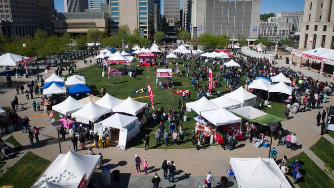 Attendees gather in the Public Square at the beginning of the Nashville Cherry Blossom Festival on April 9, 2016.
