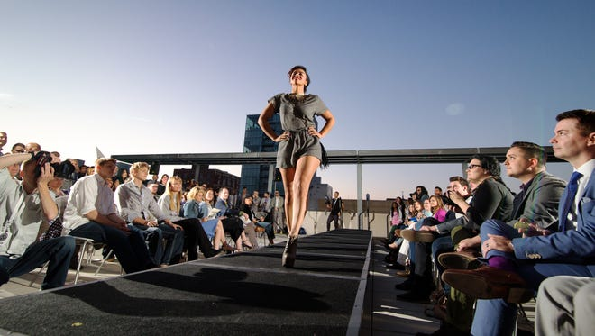 A photo by Justin Torner shows a rooftop fashion show at Hotel Vitro in May 15, 2015. Fashion shows will return to the rooftop as apart of the first FlyOver Fashion Festival in Iowa City beginning May 5, 2016.