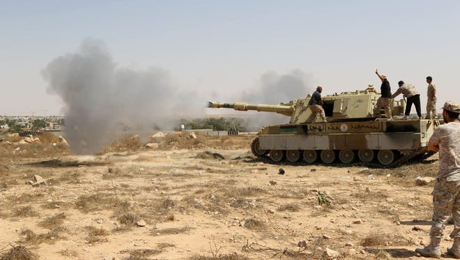 Forces loyal to Libya's UN-backed unity government fire from a tank in Sirte's center towards Ouagadougou as they advance to recapture the city from the Islamic State.