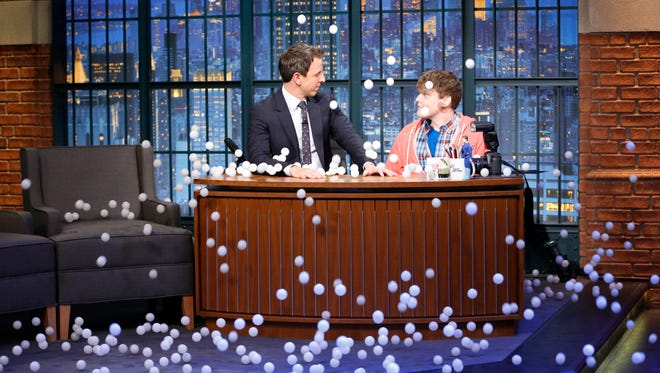 """Late Night"" host Seth Meyers and writer Ben Warheit as Seth's nephew ""Derrick"" during a sketch on October 29, 2015."