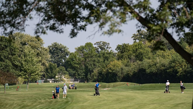 The Oshkosh North and West high school girls' golf teams compete in 2016 at Lakeshore Municipal Golf Course in Oshkosh.