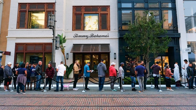 Customers wait in line for the release of the Apple iPhone 7 and the latest Apple Watches at the the Grove in Los Angeles.