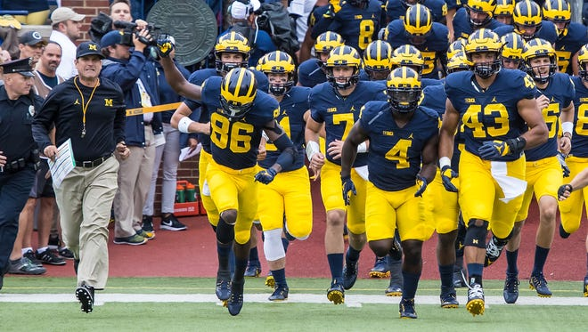 The Michigan football team takes the field in September 2016.