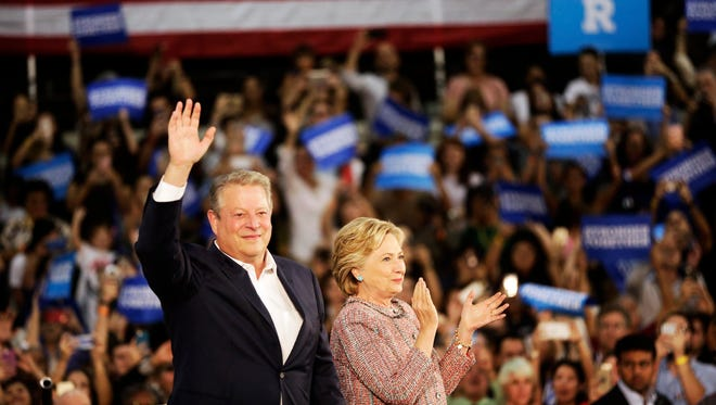 Democratic presidential nominee Hillary Clinton and former Vice President Al Gore address the crowd during a rally at Miami Dade College on Tuesday, Oct. 11, 2016. Both Clinton and Gore focused their speeches on climate change and their plans to address it.