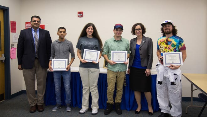 The Highlanders swept the 2016 Brain Bowl competition at Indian River State College. From left are Dr. Samuel Mikhail, Brian Hernandez, Cristiana West, Christian Garnett, Dr. Marta Cronin, IRSC vice president of Academic Affairs, and Joshua Parrish.
