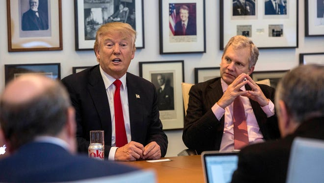 """President-elect Donald Trump, left, and""""New York Times"""" publisher Arthur Sulzberger Jr. during a meeting with editors and reporters at The New York Times building on Nov. 22."""