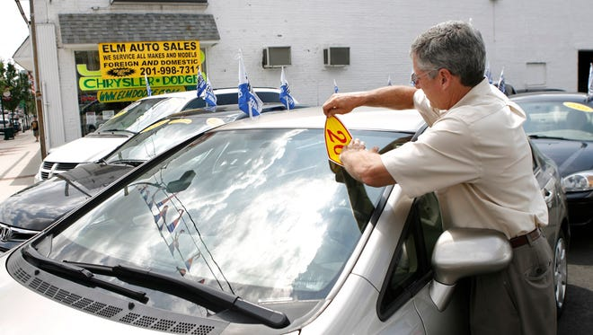 More consumers are trading in cars that are worth less than the owe on them. Trade-ins become used cars, like these in this 2009 file photo