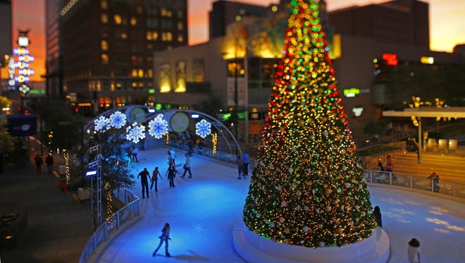 People get into the spirit of the season as they take to the ice and skate around the large Christmas tree at the CitySkate Holiday Ice Rink in downtown Phoenix. The rink along Central Avenue will be open through Jan. 8. People ice skate around a giant Christmas tree at CitySkate Holiday Ice Rink Tuesday, Dec. 13, 2016 in Phoenix, Ariz.  The rink along Central Avenue in downtown Phoenix is open through Jan 8th during select times.