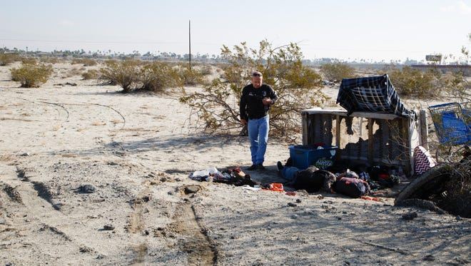 Cathedral City police officer Dwayne Hodge approacheed a homeless resident's camp in Cathedral City, Thursday, January 5, 2017.