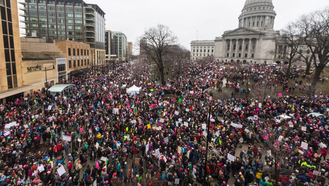 People protest around the Capitol Square last month at the Women's March on Madison.