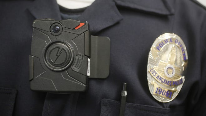 In this 2014 file photo, a Los Angeles police officer wears an on-body camera during a demonstration.