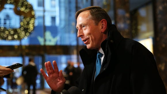 David Petraeus speaks to members of the media while