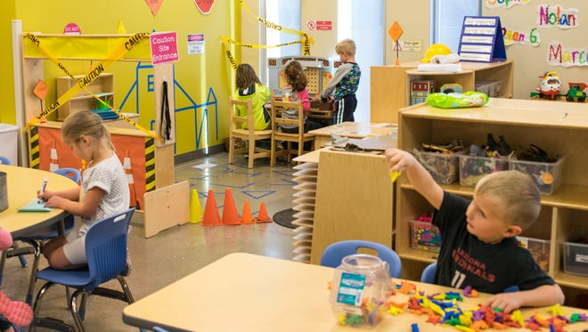 Students play in Susie Markosian's pre-kindergarten class at Sue Sossaman Early Childhood Development Center in Queen Creek on Feb. 15, 2017. Tempe is exploring ways to expand preschool to children from low-income families.