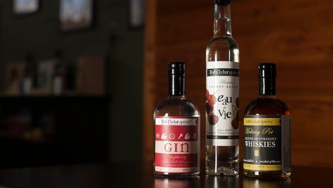 Bottles of spirits shown on Friday, March 10, 2017 at Red Cedar Spirits in East Lansing including a gin with Michigan raspberries, a pure cherry brandy made from Michigan Montmorency cherries and a straight whiskey blend.