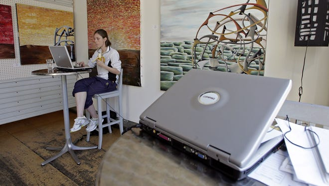 SAN FRANCISCO - JANUARY 24:  Rebecca Looysen uses free wireless internet access at Cafe Canvas January 24, 2006 in San Francisco, California. According to a survey by JiWIre, a leading Wi-Fi hot spot directory, San Francisco has more public Wi-Fi hot spots per capita than any city in the world. The city boasts 801 public hot spots, with 368 of those free of charge.  (Photo by Justin Sullivan/Getty Images)