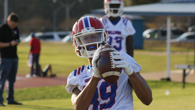 Louisiana Tech wide receiver Adrian Hardy catches a pass during spring practice.