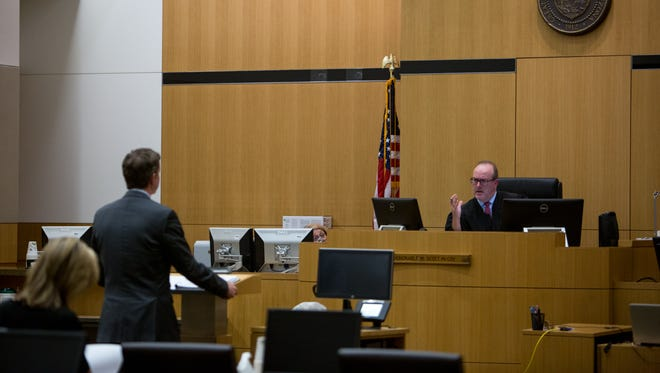 Judge Scott McCoy speaks to Attorney Craig Hoffman during arguments for Aaron Saucedo's case at the Maricopa County Superior Courthouse in Phoenix on May 17, 2017.