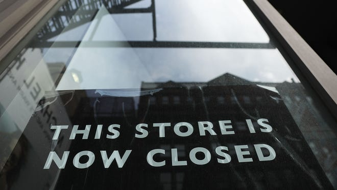 A sign announces the closing of a retail store in lower Manhattan on April 17, 2017.