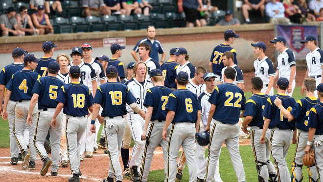 Teams shake hands as Castle beats Reitz during the Class 4A semis at Bosse Field Friday, May 26, 2017.