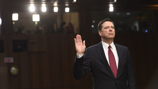 Former FBI director James Comey is sworn-in before a hearing in front of the Senate Intelligence Committee in Washington.