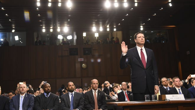 Former FBI director James Comey is sworn in at the Senate Intelligence Committee hearing on June 8, 2017.