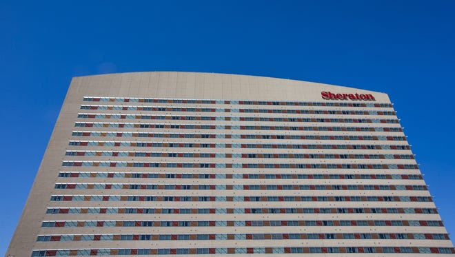 Phoenix has entered into negotiations to sell the city-owned Sheraton Grand Phoenix downtown hotel for $255 million.