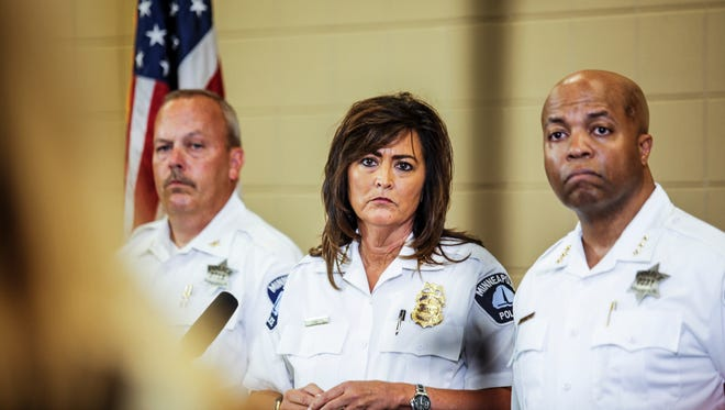 Minneapolis police chief Janee Harteau, center, stands with police inspector Michael Kjos, left, and assistant chief Medaria Arradondo during a news conference Thursday, July 20, 2017, Minneapolis. It was the first time she appeared publicly since the police shooting death of Justine Damond on Saturday.