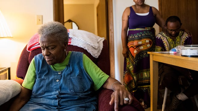 "Betty Watson, also known as ""Blind Betty,"" leads a prayer in her home on Tuesday, July 18, 2017."