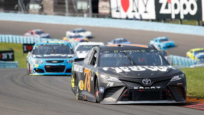 Martin Truex Jr. drives to a victory at last year's Monster Energy NASCAR Cup Series race at Watkins Glen International.