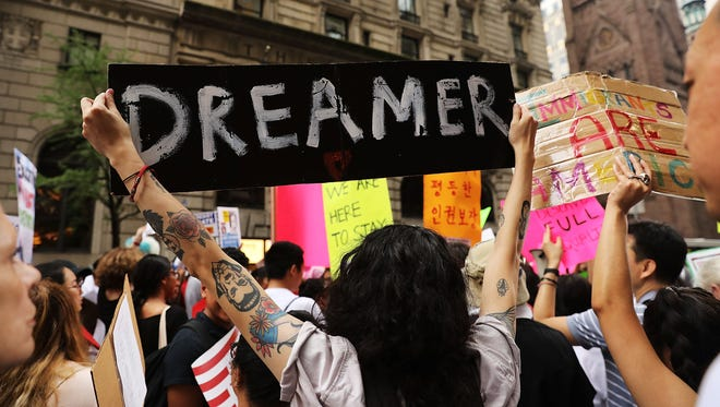 Dozens of immigration advocates and supporters attend a rally outside of  Trump Tower along Fifth Avenue on Aug. 15, 2017 in New York. The activists were rallying on the five-year anniversary of President Obama's executive order, DACA - Deferred Action for Childhood Arrivals, protecting undocumented immigrants brought to the U.S. as children.