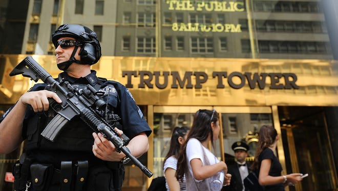 Police stand guard outside of Trump Tower on Aug. 4, 2017 in New York City. Following a dispute with the Trump Organization over a lease, the Secret Service, which protects all US presidents, has moved to a small trailer on a side street outside of Trump Tower. The federal agency had been renting office space in Donald Trump's Midtown Manhattan skyscraper since 2015 before a disagreement over the terms and costs for rent for a command post.