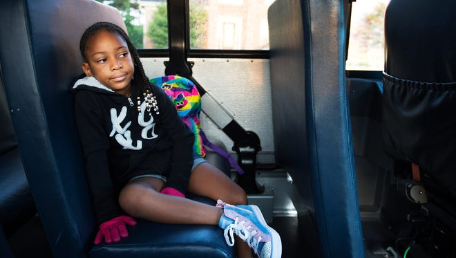 A Monarch Elementary student rides the bus on the first day of school on Tuesday, August 22, 2017.