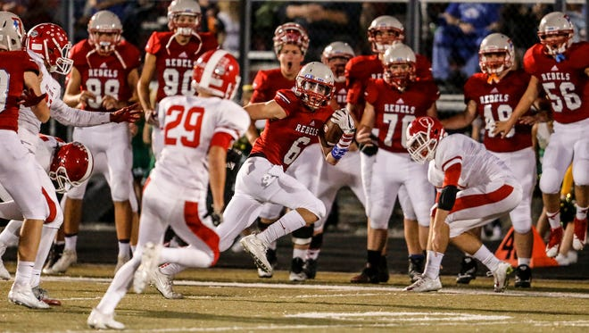 Roncalli's Jacob Luedeman (6) runs away from Plainfield defenders on Friday.