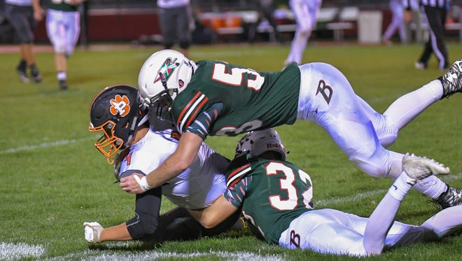 Holden Reilly (4) of Plymouth gets brought down by Alec Moriarty (5) and Samuel Rucks (32) of Berlin. The Berlin Indians hosted the Plymouth Panthers in an ECC conference football game Friday night, September 8, 2017.