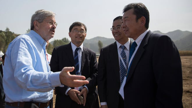 Ambassador Terry Branstad speaks with people attending the groundbreaking of the China-US Demonstration Farm on Saturday, Sept. 23, 2017, in Luanping County, Hebei, China.