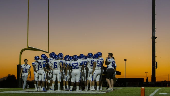 Dobson players huddle before the game against Red Mountain at Red Mountain High School on Thursday, Sept. 28, 2017 in Mesa, Ariz.