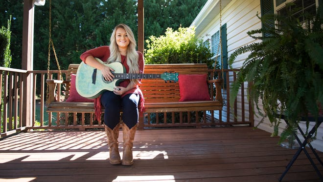 Ashland Craft, a contestant on The Voice, is pictured on the front porch of her Piedmont home on Monday, October 2, 2017.