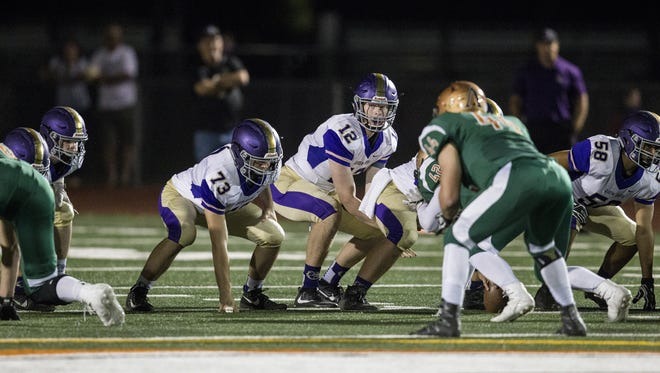 Queen Creek's Devin Larsen gets ready for the snap against Campo Verde during the 1st quarter at Campo Verde High School on Friday, Oct. 6, 2017 in Gilbert, Ariz.