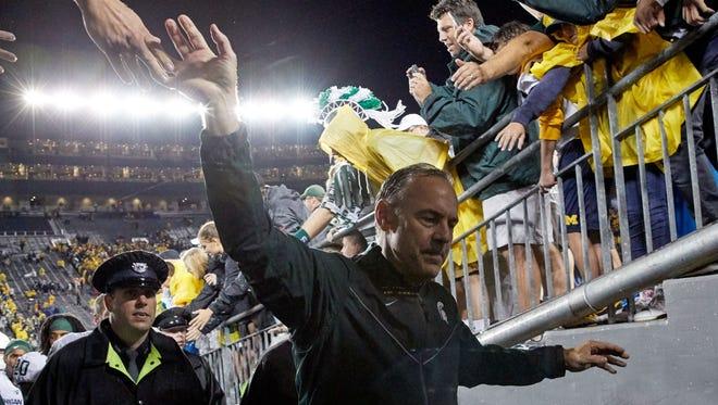 Michigan State coach Mark Dantonio leaves the field after defeating Michigan, 14-10, at Michigan Stadium on Oct. 7.