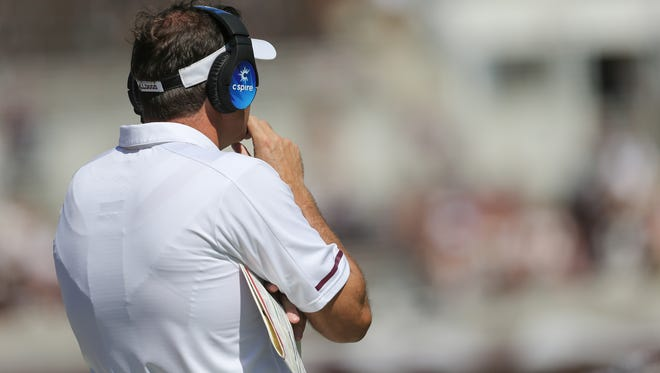 Mississippi State head football coach Dan Mullen looks on from the sideline.