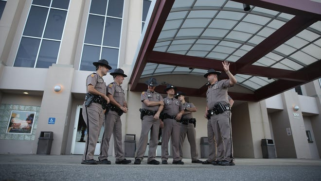 Florida Highway Patrol officers stand outside the Curtis M. Phillips Center for the Performing Arts as they prepare the venue for Thursday's scheduled speech by white nationalist Richard Spencer on Oct. 18, 2017 in Gainesville, Florida.  Reports indicate security for the event will cost about $500,000.