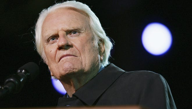 Billy Graham preaches on the third night of the Greater Los Angeles Billy Graham Crusade on Nov. 20, 2004, in Pasadena, Calif.