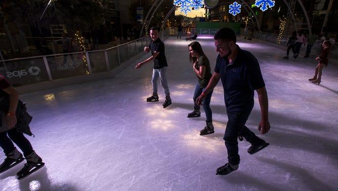 Skaters enjoy the CitySkate ice rink on Friday, Nov. 24, 2017 in Phoenix.